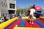 Jay Hoy and Will Dunestone joust during an Associated Students of Western Nevada BBQ and club fair at Western Nevada College in Carson City, Nev., on Thursday, Sept. 1, 2016. The event raps up a weeklong celebration as the new school year begins. <br />Photo by Cathleen Allison