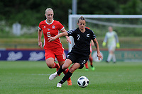 Elise Hughes of Wales Women's' vies for possession with Ria Percival of New Zealand Women's during the Women's International Friendly match between Wales and New Zealand at the Cardiff International Sports Stadium in Cardiff, Wales, UK. Tuesday 04 June, 2019