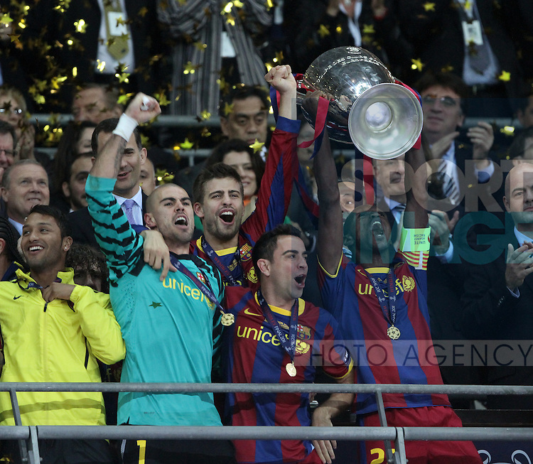Barcelonas Eric Abidal lifts the trophy
