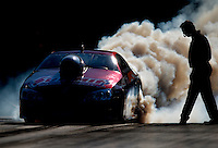 Sept. 19, 2010; Concord, NC, USA; NHRA pro stock driver Greg Anderson does a burnout during the O'Reilly Auto Parts NHRA Nationals at zMax Dragway. Mandatory Credit: Mark J. Rebilas-