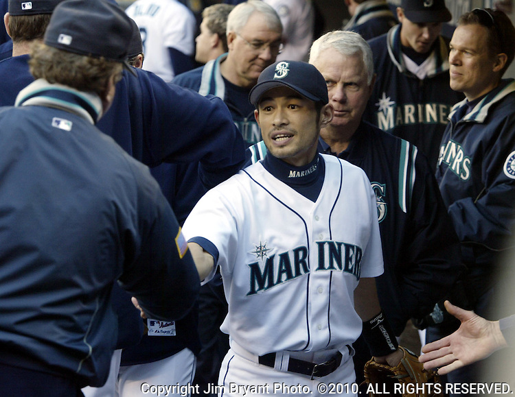 Seattle Mariners' bench coach Rene Lachemann ,left, congratulates Ichiro Suzuki for hitting 262 hits in a season after their 3-0 loss to theTexas Rangers in the inning at Safeco Field on Sunday, Oct. 3, 2004 in Seattle. Jim Bryant Photo. ©2010. ALL RIGHTS RESERVED.
