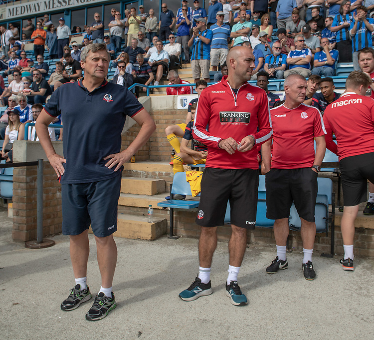 Bolton Wanderers manager Jimmy Phillips  (left) and the support staff<br /> <br /> Photographer David Horton/CameraSport<br /> <br /> The EFL Sky Bet League One - Gillingham v Bolton Wanderers - Saturday 31st August 2019 - Priestfield Stadium - Gillingham<br /> <br /> World Copyright © 2019 CameraSport. All rights reserved. 43 Linden Ave. Countesthorpe. Leicester. England. LE8 5PG - Tel: +44 (0) 116 277 4147 - admin@camerasport.com - www.camerasport.com