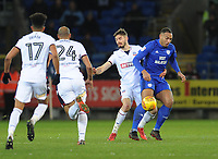 Cardiff City's Kenneth Zohore under pressure from Bolton Wanderers' Dorian Dervite<br /> <br /> Photographer Kevin Barnes/CameraSport<br /> <br /> The EFL Sky Bet Championship - Cardiff City v Bolton Wanderers - Tuesday 13th February 2018 - Cardiff City Stadium - Cardiff<br /> <br /> World Copyright &copy; 2018 CameraSport. All rights reserved. 43 Linden Ave. Countesthorpe. Leicester. England. LE8 5PG - Tel: +44 (0) 116 277 4147 - admin@camerasport.com - www.camerasport.com