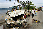 Vehicles and debris line the beach-front street after tidal waves hit Patong Beach on Phuket Island, Thailand. On December 26, 2004, a major earthquake generated tsunamis that ravaged coastlines from Southeast Asia to Africa. Approximately 275,000 people were killed and tens of thousands were left homeless, making it one of the deadliest natural disasters in modern history.
