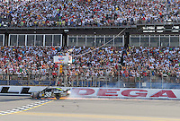 Apr 26, 2009; Talladega, AL, USA; NASCAR Sprint Cup Series driver Ryan Newman drives under the checkered flag after being involved in a crash on the last lap during the Aarons 499 at Talladega Superspeedway. Mandatory Credit: Mark J. Rebilas-