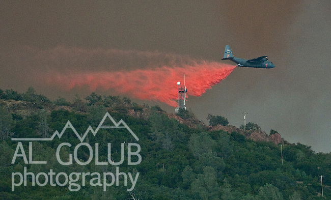 Bear Valley, California, July 26, 2008-Telegraph Fire near Yosemite National Park.C130 tanker drop retardant on Mt. Bullion Ridge to protect Cell phone tower on Fremont Peak.  Image taken from Highway 49. Between Mt. Bullion and Bear Valley..Photo by Al GOLUB/Golub Photography.