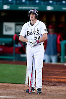 Koby Peebles (24) of the Missouri State Bears adjusts his gloves during a game against the Southern Illinois University- Edwardsville Cougars at Hammons Field on March 9, 2012 in Springfield, Missouri. (David Welker / Four Seam Images)
