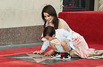 Lucy Liu Honored With Star On The Hollywood Walk Of Fame on May 01, 2019 in Hollywood, California.<br /> a_Lucy Liu 014  and son