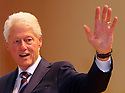 Former US President Clinton waves after finishing a visit to Queen's University Belfast, Tuesday, April 10th, 2018. Tuesday marks 20 years since politicians from Northern Ireland and the British and Irish governments agreed what became known as the Good Friday Agreement. It was the culmination of a peace process which sought to end 30 years of the Troubles. Two decades on, the Northern Ireland Assembly is suspended in a bitter atmosphere between the two main parties. Photo/Paul McErlane