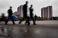 People Walking In A Suburban Building Development in Xianyang, China.  © LAN