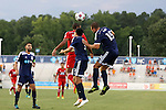 09 July 2014: Dallas' Tesho Akindele (in red) challenges for a header with Carolina's Kupono Low (3) and Austen King (15). The Carolina RailHawks of the North American Soccer League played FC Dallas of Major League Soccer at WakeMed Stadium in Cary, North Carolina in the quarterfinals of the 2014 Lamar Hunt U.S. Open Cup soccer tournament. FC Dallas won the game 5-2.