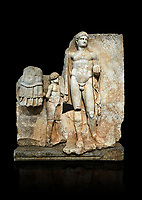 Roman Sebasteion relief  sculpture of Emperor Nero with captive, Aphrodisias Museum, Aphrodisias, Turkey.   Against a black background.<br /> <br /> Naked warrior emperor Nero holds the orb of world rule in one hand and crowns the military trophy with the other. Between the trophy and the emperor stands a bound captive boy. He wears long barbarian trousers and looks up at Nero.