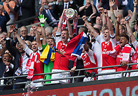 Per Mertesacker of Arsenal lifts the FA Cup after the 2-1 win over Chelsea during the FA Cup Final match between Arsenal v Chelsea, Wembley stadium, London on 27th May 2017