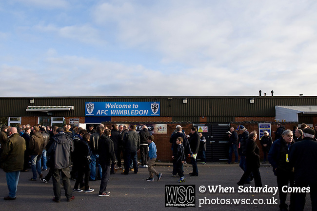 AFC Wimbledon 4 Portsmouth 0, 16/11/2013. Kingsmeadow, League Two. Wimbledon and Portsmouth have had turbulent histories and both supporter-owned clubs are now in League Two. AFC Wimbledon supporters gather behind the Paul Strank Main Stand before the game.  Photo by Simon Gill.