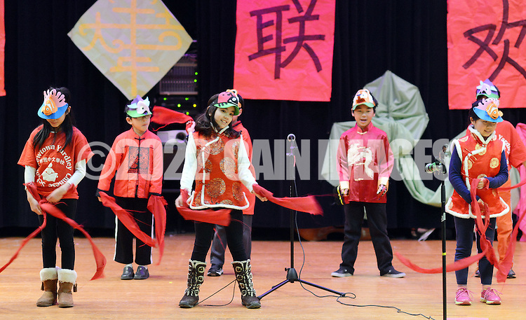 A group of third graders perform onstage as the Newtown-Yardley Chinese School celebrates Chinese New Year at Richboro Middle School Saturday February 21, 2015 in Richboro, Pennsylvania. (Photo by William Thomas Cain/Cain Images)