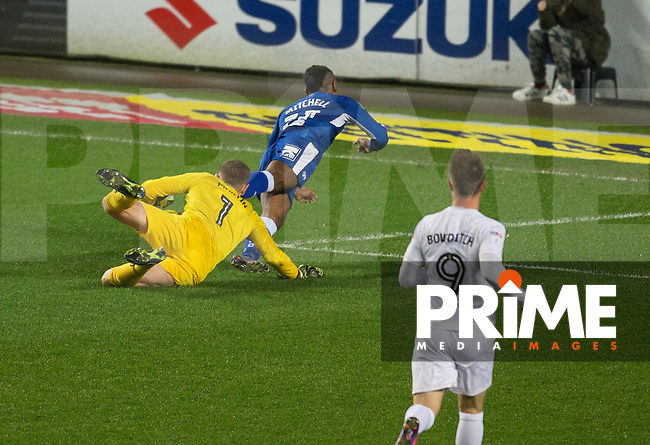 Reece Mitchell of Chesterfield is brought down by Goalkeeper David Martin of Milton Keynes Dons for a penalty during the Sky Bet League 1 match between MK Dons and Chesterfield at stadium:mk, Milton Keynes, England on 22 November 2016. Photo by Andy Rowland.