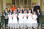 Pupils from Liselton NS who received their 1st Communion at Ballydonoghue Church, Liselton on Saturday last. Front : Katie Moriarity, Caoimhe Lyons, Edel Joy, Tori O'Connor, Erin Flavin & Rebecca Barry.Middle; Emmett Kelly, Conor Ferris, Robert Foley, Tadgh O'Carroll, Michael Nolan, Ronan O'Neill, Ryan Doyle & Tadgh Barry. Back : Finola Fogarty, Teacher & Fr. John Lawlor...