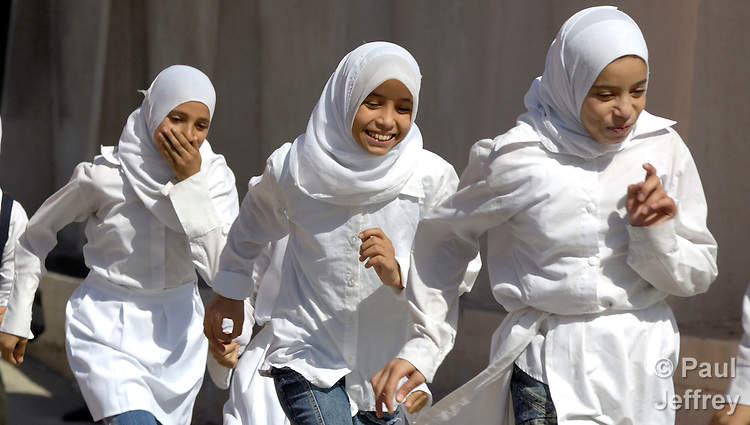 Girls run in the physical education class at Al-Zaytoon School, located in the Jabalyia Refugee Camp in the war-torn Gaza Strip.