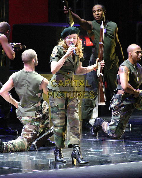 """MADONNA.On her """"Re-Invention"""" tour performs live in concert at Madison Square Garden, New York,USA,.23rd June 2004..full length gig music on stage black beret hat army unifrom camouflage khaki singing.www.capitalpictures.com.sales@capitalpictures.com.©Capital Pictures"""