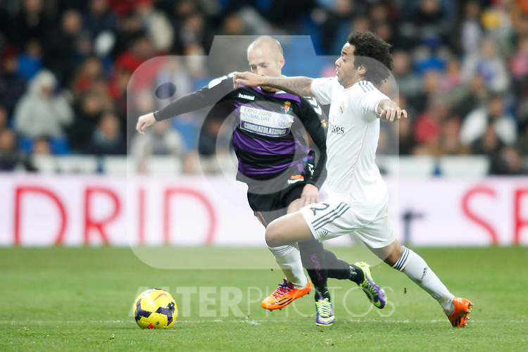 Real Madrid´s Marcelo (R) and  Valladolid´s Larsson during La Liga 2013-14 match at Bernabeu Stadium in Madrid, Spain. November 30, 2013. (ALTERPHOTOS /Victor Blanco)