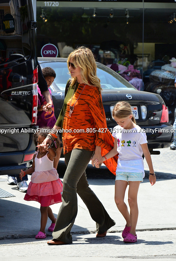 May 19th 2012 ..Heidi Klum leaving Karate class with kids & then going to DeVino cafe in Brentwood California . Heidi was wearing a red orange green tie dye dress shirt ...AbilityFilms@yahoo.com.805-427-3519.www.AbilityFilms.com..