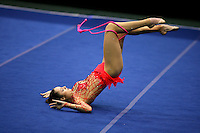 Anna Bessonova of Ukraine recatch moment with rope at San Francisco Invitational on February 11, 2006. Bessonova won All-Around competition. (Photo by Tom Theobald)