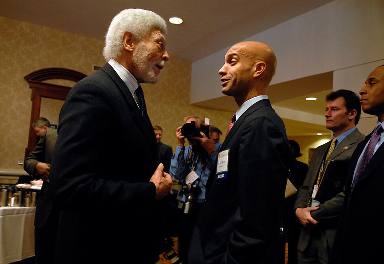 Mayor of Washington D.C. Adrian Fenty, right, speaks with mayor of Oakland, Ca., and former Congressman Ron Dellums, outside the ballroom of the Winter meeting of the U.S. Conference of Mayors held at the Capital Hilton.