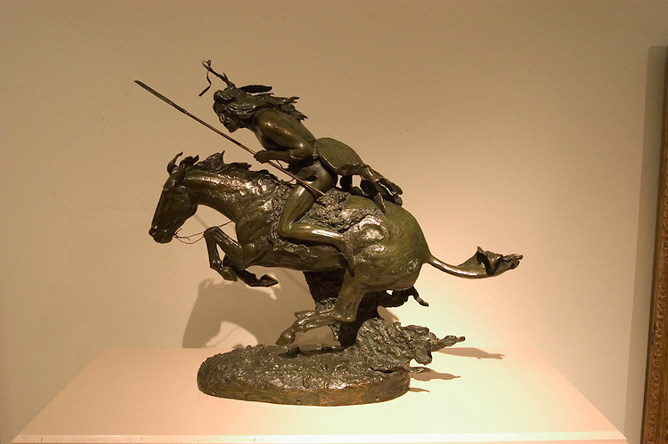 "WY: Wyoming, Cody: Buffalo Bill Historical Center...Whitney Museum of Western Art.  .Frederic Remington sculpture ""The Cheyenne"".Photo #: yellow622..Photo copyright Lee Foster, 510/549-2202, lee@fostertravel.com, www.fostertravel.com.."
