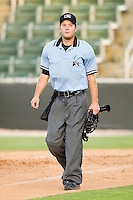 Home plate umpire Blake Felix walks off the field at the end of the South Atlantic League game between the Lakewood BlueClaws and the Kannapolis Intimidators at Fieldcrest Cannon Stadium on July 17, 2011 in Kannapolis, North Carolina.  The BlueClaws defeated the Intimidators 4-3.   (Brian Westerholt / Four Seam Images)