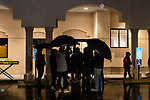 WATERBURY, CT. 01 January 2019-010119 - People stand under umbrellas in the pouring rain of the Mosque's parking lot during a peaceful protest of the Boards management of the Mosque at Masjid Al Mustafa in Waterbury on Tuesday. Bill Shettle Republican-American