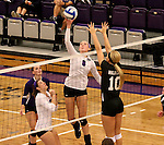 SIOUX FALLS, SD - SEPTEMBER 23: Emily Johnson #8 from University of Sioux Falls tips the ball past Alyssa Frauendorfer #10 from Wayne State Tuesday night at the Stewart Center.  (Photo by Dave Eggen/Inertia)