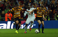 Pictured: Nathan Doyle (L), Roland Lamah (C). Sunday 24 February 2013<br /> Re: Capital One Cup football final, Swansea v Bradford at the Wembley Stadium in London.