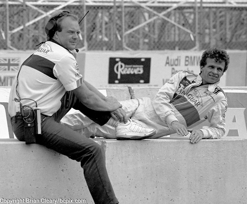 Jan Lammers relaxes as he talks to a crewman at the IMSA GTP/Lights race at the Florida State Fairgrounds in Tampa, FL, October 1, 1989. (Photo by Brian Cleary/www.bcpix.com)