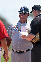 GCL Marlins manager Julio Garcia (13) during the lineup exchange before a game against the GCL Nationals on June 28, 2014 at the Carl Barger Training Complex in Viera, Florida.  GCL Nationals defeated the GCL Marlins 5-0.  (Mike Janes/Four Seam Images)