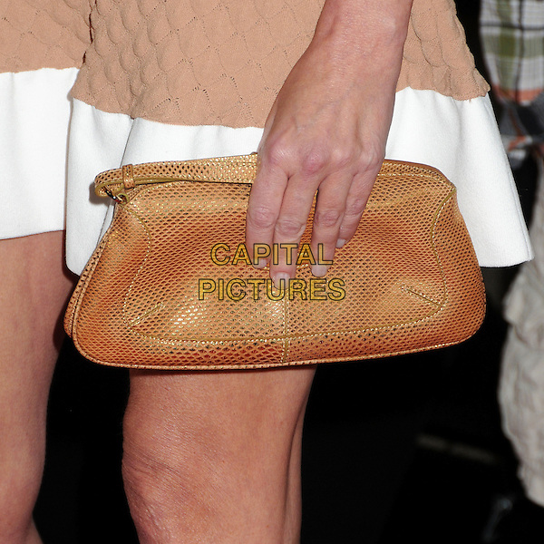 "Heather Locklear's bag .Attending the ""Scary Movie 5"" Los Angeles film premiere held at the Cinerama Dome,  Hollywood, California, USA, .11th April 2013..detail beige brown tan purse hands hand clutch .CAP/ADM/BP.©Byron Purvis/AdMedia/Capital Pictures"