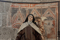 "Statue of St Teresa de Avila ""transverberada"", San Blass Chaptel (Capilla de san Blas), Cathedral, Avila, Spain. Avila Cathedral, 11th-15th century, is regarded as the first Spanish Gothic Cathedral and its style is French influenced. Santa Teresa (1515-82), was a Carmelite nun, canonized 1622. Photograph by Manuel Cohen."