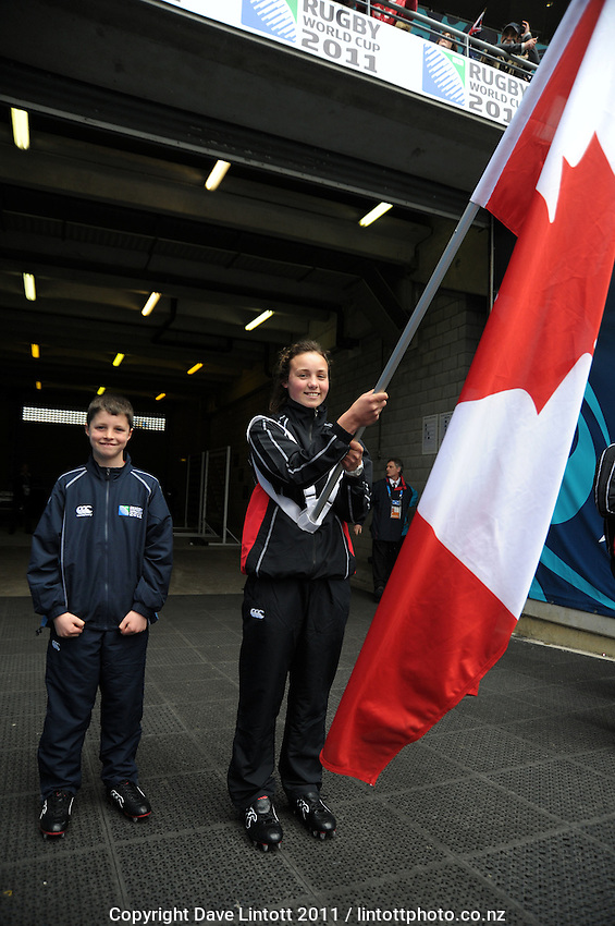 The Canada flagbearer the All Blacks v Canada pool A match of the 2011 IRB Rugby World Cup at Wellington Regional Stadium, New Zealand on Sunday, 2 October 2011. Photo: Dave Lintott / lintottphoto.co.nz