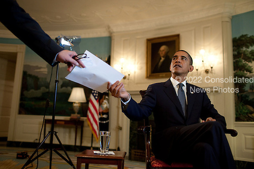 Washington, DC - October 8, 2009 -- United States President Barack Obama prepares to record the weekly video address in the Diplomatic Reception Room of the White House, October 9, 2009. .Mandatory Credit: Chuck Kennedy - White House via CNP