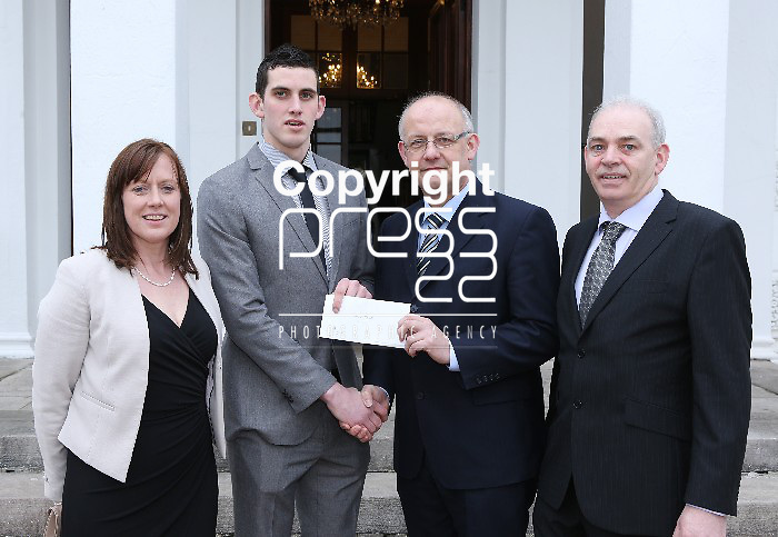 Dr. Pat Phelan, Associate Registrar, UL (third from left) presents the Paddy Dooley Rowing Scholarship to Shane Haugh, a first year B.Sc student at the University of Limerick.  Shane from Bohermore, Gregnamanagh, Co. Kilkenny received the scholarship because of his prowess in rowing and academic achievement.  Also in the photograph are are his parents Patti and Rory.  Picture Liam Burke/Press 22 (with compliments)  Press Release: The Paddy Dooley Rowing Scholarship has been established through the generosity of the Dooley family.  The family, who are from Limerick decided to establish the scholarship in honour of their father Paddy, who captained the Irish Olympic eight in the 1948 Olympic Games in London.
