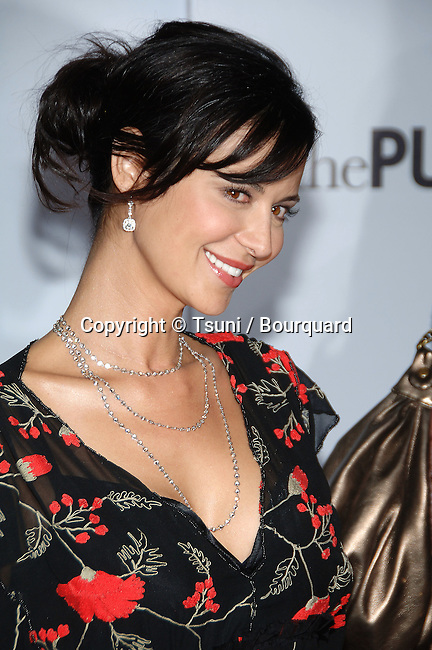 Catherine Bell  arriving at the PURSUIT of Happiness Premiere at the Westwood Village Theatre In Los Angeles.<br /> <br /> headshot<br /> smile