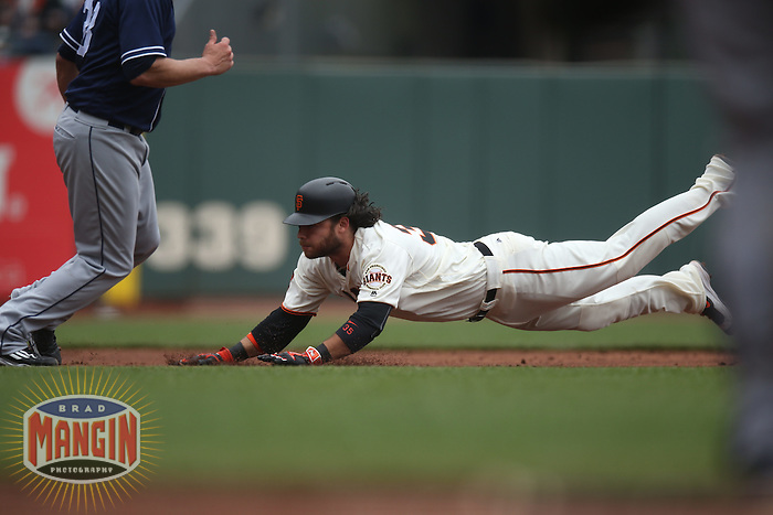 SAN FRANCISCO, CA - MAY 25:  Brandon Crawford #35 of the San Francisco Giants slides into third base against the San Diego Padres during the game at AT&T Park on Wednesday, May 25, 2016 in San Francisco, California. Photo by Brad Mangin