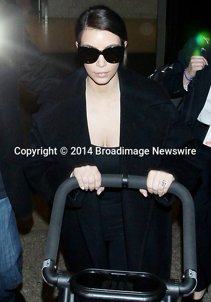 Pictured: Kim Kardashian<br /> Mandatory Credit &copy; CALA/Broadimage<br /> Kim Kardashian arriving at the Los Angeles International Airport<br /> <br /> 2/28/14, Los Angeles, California, United States of America<br /> <br /> Broadimage Newswire<br /> Los Angeles 1+  (310) 301-1027<br /> New York      1+  (646) 827-9134<br /> sales@broadimage.com<br /> http://www.broadimage.com
