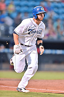 Asheville Tourists first baseman Brian Mundell (15) runs to first base during a game against the  Hagerstown Suns at McCormick Field on September 2, 2016 in Asheville, North Carolina. The Suns defeated the Tourists 5-1. (Tony Farlow/Four Seam Images)