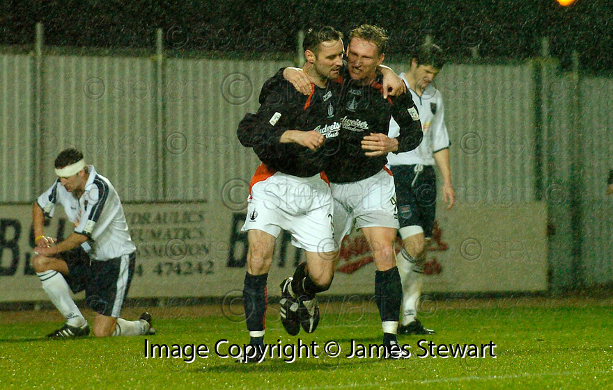 28/11/2004  Copyright Pic : James Stewart.File Name : jspa06_falkirk_v_ross_county.ANDY THOMSON IS CONGRATULATED BY DANIEL MCBREEN ..........Payments to :.James Stewart Photo Agency 19 Carronlea Drive, Falkirk. FK2 8DN      Vat Reg No. 607 6932 25.Office     : +44 (0)1324 570906     .Mobile   : +44 (0)7721 416997.Fax         : +44 (0)1324 570906.E-mail  :  jim@jspa.co.uk.If you require further information then contact Jim Stewart on any of the numbers above.........