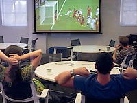 Alums watch a World Cup soccer game in the Varelas Innovation Lab during Alumni Reunion Weekend, Saturday, June 21, 2014. (Photo by Marc Campos, Occidental College Photographer)
