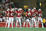University of Wisconsin special teams players huddle before a kickoff during the Fresno State game at Camp Randall Stadium in Madison, WI, on 8/23/02. The Badgers beat Fresno State 23-21.  (Photo by David Stluka)