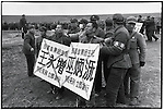 "Before their execution ""counterrevolutionaries"" Wu Bingyuan (with his eyes closed) and Wang Yongzeng bear placards with their names and crimes. Outskirts of Harbin, 5 April 1968"