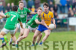 Liam Carey Beaufort jinks through the  Milltown Castlemaine defenders David Roche, Pa Wrenn and Marcus Mangan during the Mid Kerry final in Killorglin on Sunday
