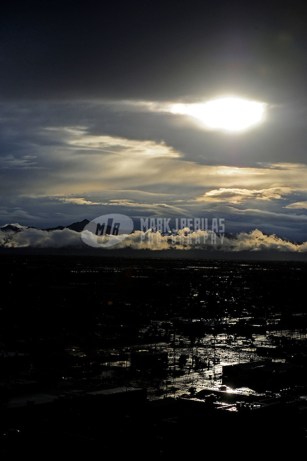 rain sun water Phoenix Arizona weather storm chaser chasing city urban road silhouette sunset clouds sun