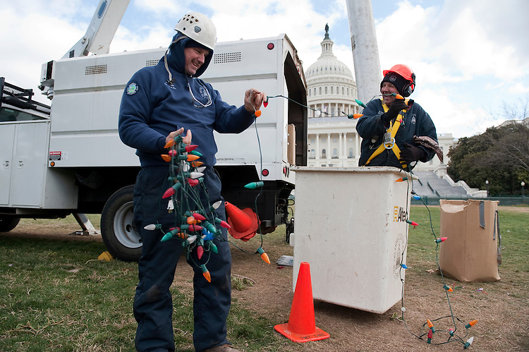 UNITED STATES - JANUARY 03:  Henry Brady, left, and Buddy Paddy, from the Architect of the Capitol tree care division, pack up lights that adorned the Capitol Christmas Tree on the west front of the Capitol.  Tree is slated to be taken out of the ground on Wednesday.(Photo By Tom Williams/CQ Roll Call)